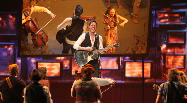 "Steve Kazee, on guitar, with the cast of the musical ""Once"" at the Tony Awards ceremony. Credit:Sara Krulwich:The New York Times"