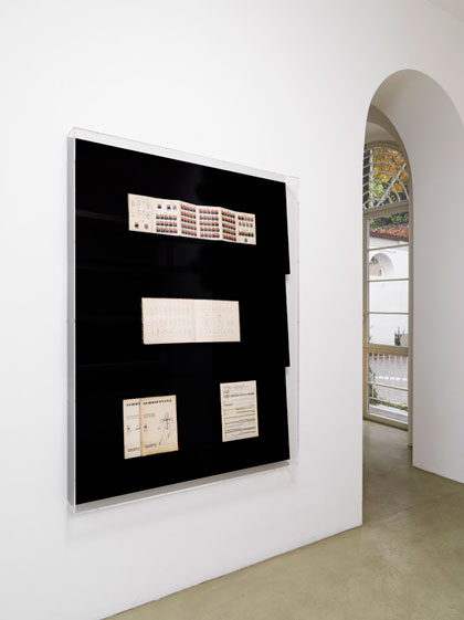 Relief (Various Notations), 2012, Wall vitrine, MDF covered with black bookbinders clooth, printed material, perspex cover, cm 120x160x12