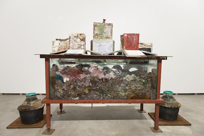 Gabriele Silli Organo del sommerso nei bagni tripudio caustico-cloridrici, 2014 9 objects made out of paper, resins, creams, textiles, animal leathers, cement installed on an iron table with glass containers  approximately 25 x 30 x20 cm each installation: 150 x 180 x 80 cm photo by Federico Maria Tribbioli courtesy Federica Schiavo Gallery, Roma