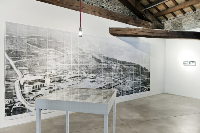 Alice Pedroletti, Senza Titolo, Mixed media installation - (objects archive, book, wall photocopies picture, photographs, table, light bulb) 2013