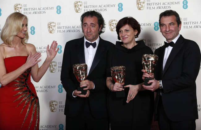 "Paolo Sorrentino (2nd L-R), Francesca Cima and Nicola Giuliano celebrate winning Film Not In The English Language for ""The Great Beauty"" with Joely Richardson (L) at the British Academy of Film and Arts (BAFTA) awards ceremony at the Royal Opera House in London February 16, 2014. (Picture: Reuters)"