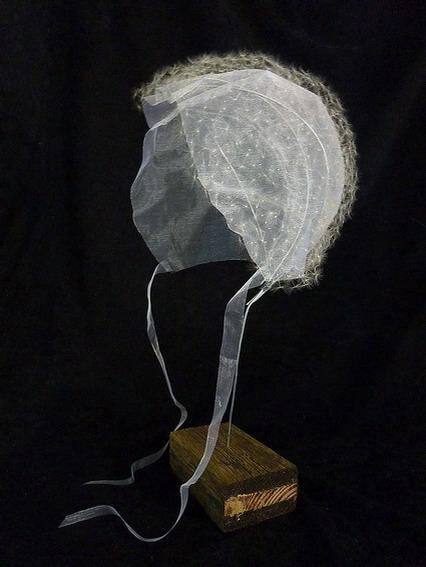 Isabel Consigliere, Per la Sopravvivenza n° 8, Scintilla, pappi di tarassaco, ferro, legno, colla, teca in plexiglass 43x43x43