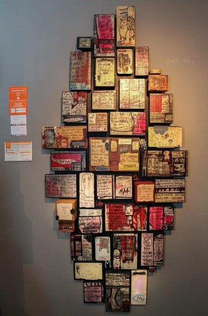 Premio-Emilbanca-Tommaso-Santucci,-Non-credo-di-essere-solo…ma-a-volte-capita-di-sentirmici,-2015,-tecnica-mista,-acrilico-e-bic-nera-su-scotch-carta-su-legno-e-materiali-di-recupero