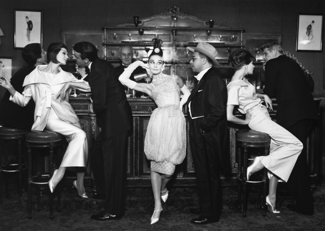 Audrey Hepburn and Art Buchwald, with Simone D'Aillencourt, Frederick Eberstadt, Barbara Mullen, and Dr. Reginald Kernan, evening dresses by Balmain, Dior, and Patou, Maxim's Paris, August 1959 Avedon © The Richard Avedon Foundation