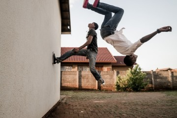Marco Casino, Kwesine, Johannesburg. Chabedi Thulo and a friend flip on the wall training for train surfing combo