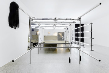 PEPO SALAZAR Untitled Installation (La fiesta de los metales), 2009 Fluorescent tube, stainless steel, 2G, paint, DM, stainless steel sheets, tripods/lamps, wig, botles