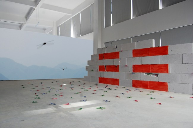 Maria Rebecca Balestra, Journey into Fragility, I'm because you are..., opera site specific realizzata per la tappa in Cina, mattoni, video, libellule di plastica, pittura industriale rossa