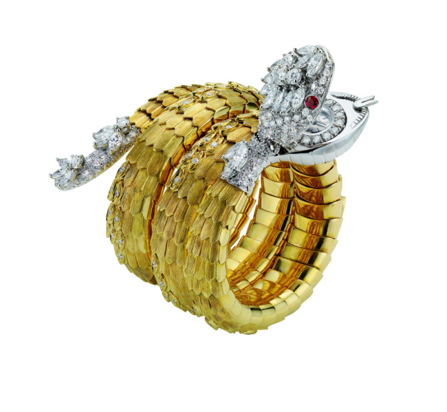 "Bulgari, ""Serpenti"", bracelet-watch in gold with rubies and diamonds, 1967"