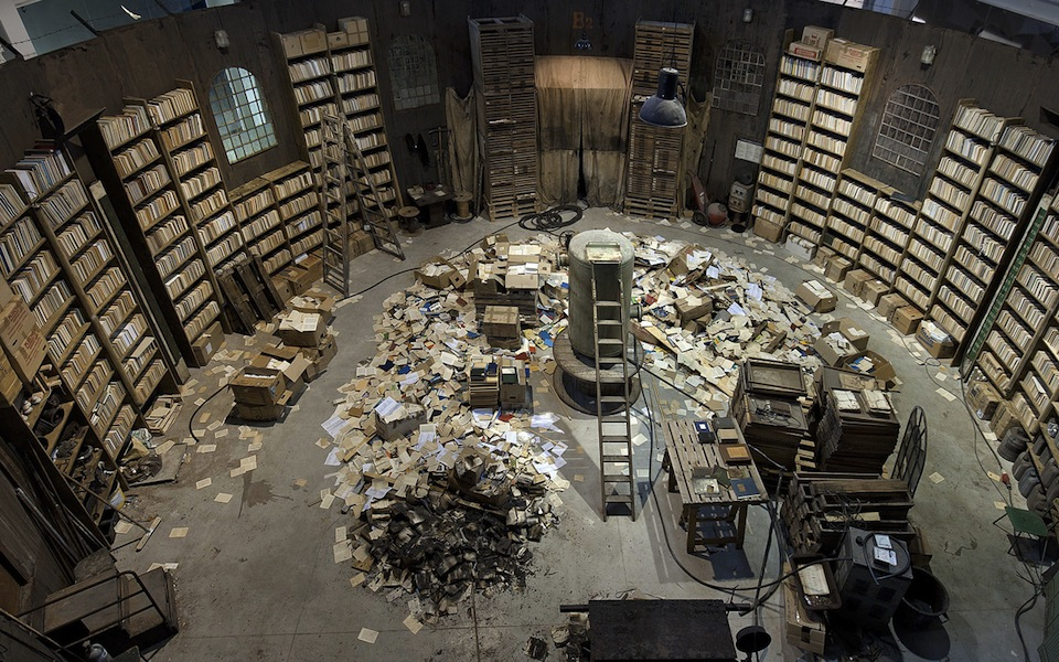 Robert Kuśmirowski, STRONGHOLD, 2013, wood, glue, pigments, paint, carton, rubber, plastic, glass, metal, curtains, paper, books, Lyon Biennale, dep. in MAC Lyon, 8x24x22 m