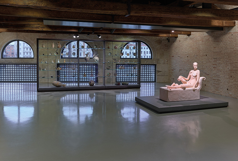 Damien Hirst, (left to right) A collection of jugs and vessels from the wreck of the 'Unbelievable', Reclining Woman, Punta della Dogana. Photographed by Prudence Cuming Associates © Damien Hirst and Science Ltd.  All rights reserved, DACS 2017
