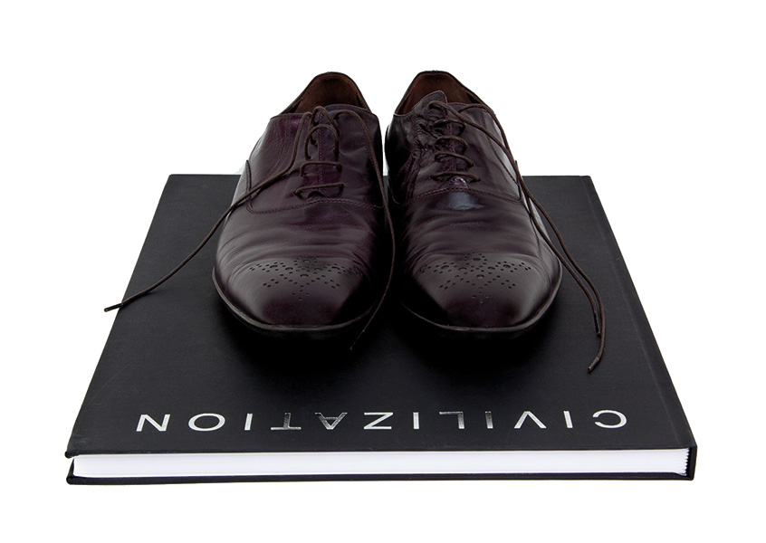 Mounir Fatmi, Civilization, 2013, artist's shoes and book, cm 30x43, edition of 5
