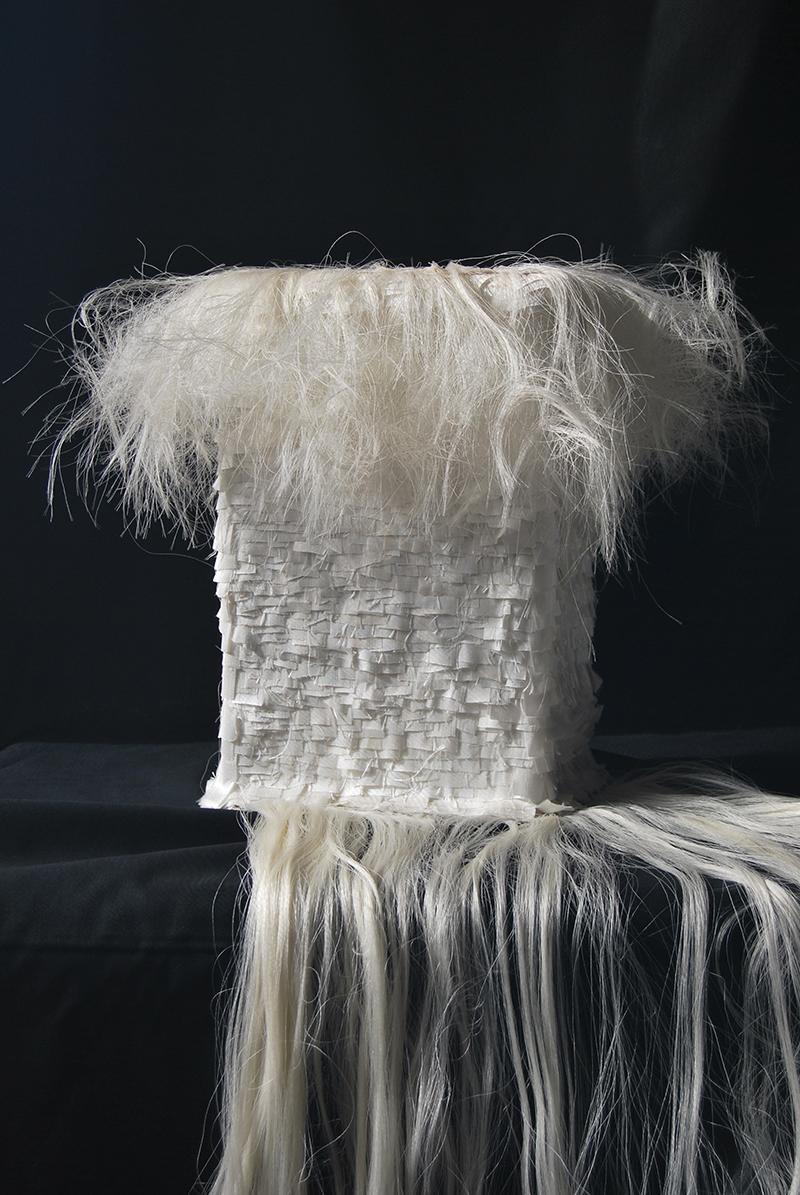 Manuela Toselli, Deep rooted (profondamente radicato - particolare), 2015, seta, legno e chiodi cm 18x29x14
